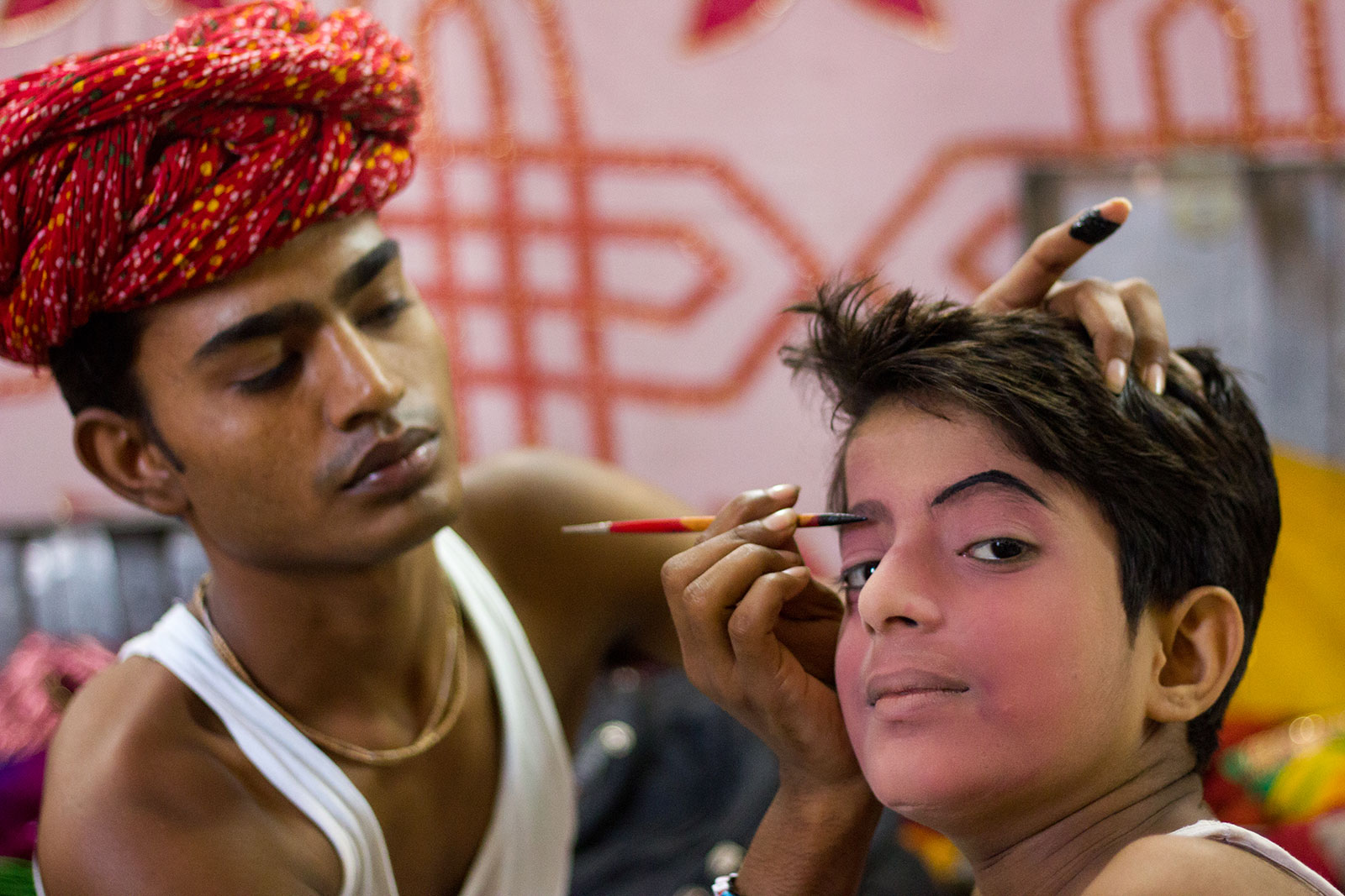 Ramleela artists doing makeup backstage