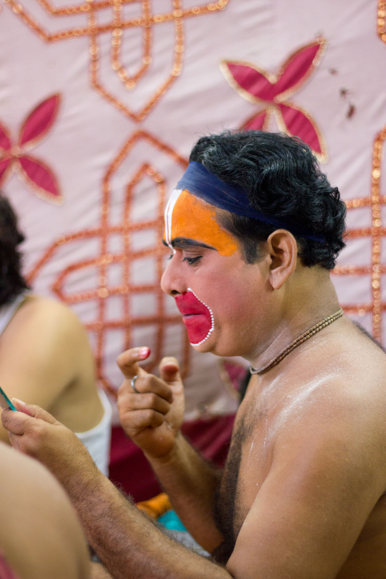 Artist Playing Hanuman doing makeup backstage Ramleela