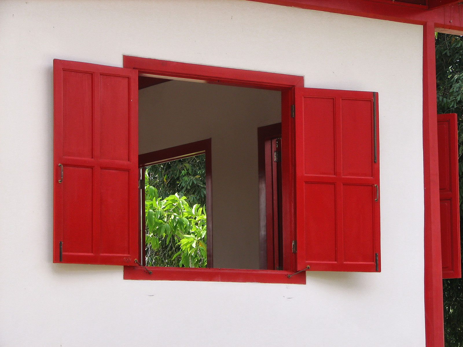 Red Window of a white building