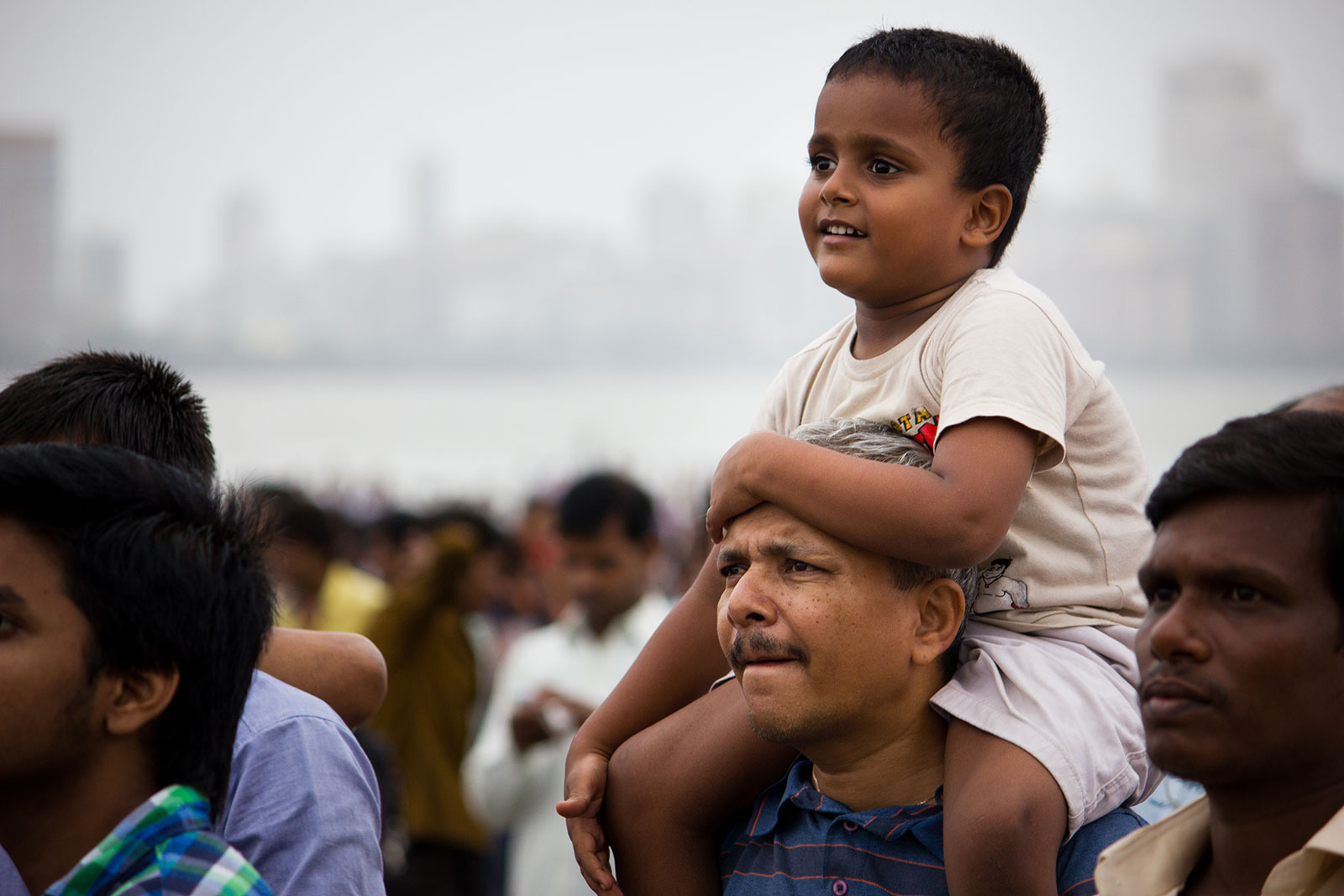 Portrait of smiling Boy Sitting on His Dads Shoulders